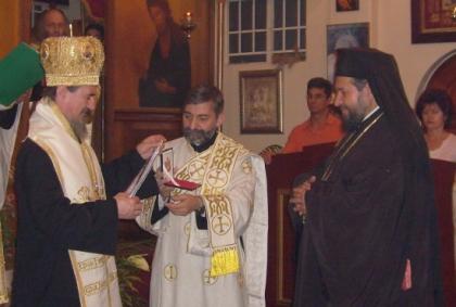 Bishop Atanasije (left) confers the Order of St Symeon on Archbishop Seraphim