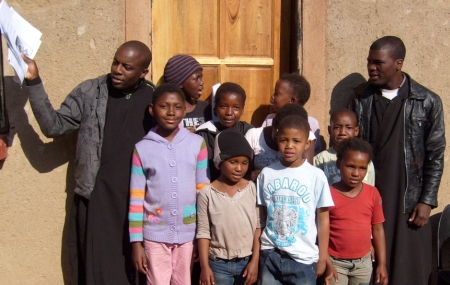 Dimitrios and Petros, two of the students from the Catechetical School, with some of the children at Atteridgevillel