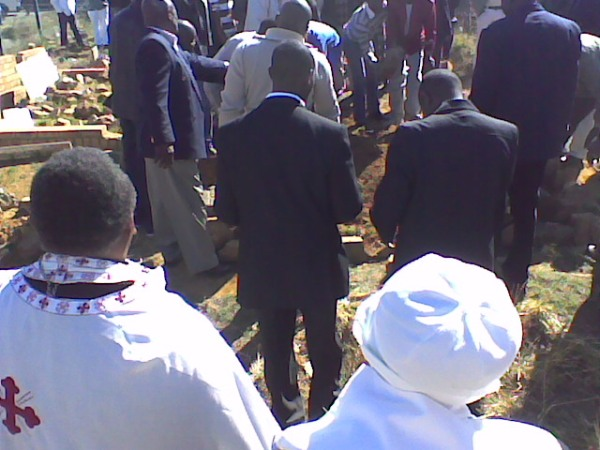 Filling in the grave at the funeral of the newly-departed servant of God, Nicholas Sibiya.