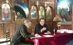 Father Gerasimos and Archbishop Damaskinos at the clergy synaxis on 13 December 2012