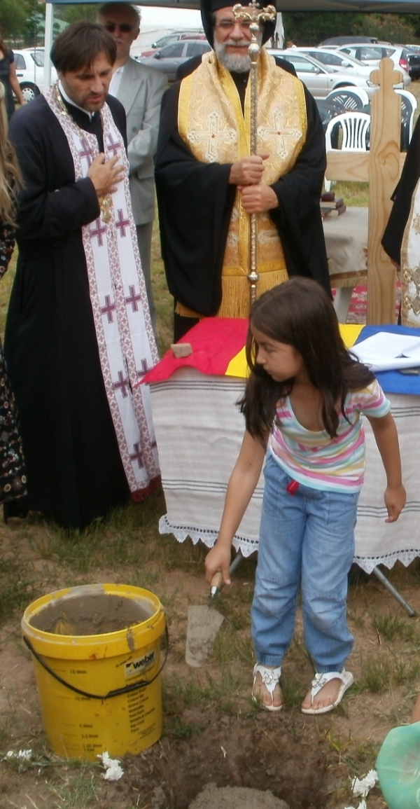 Cementing the foundation stone -- everyone present, young and old, took part