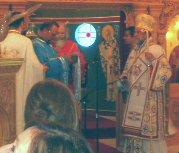"The newly-ordained deacon Anastasios is vested as a deacon while the bishop proclaims ""Axios!"" ""He is worthy!"""