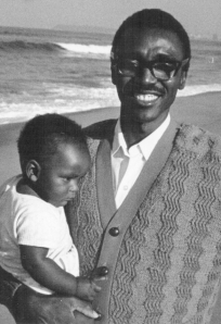 Shihala Hamupembe with daughter Ndahafa on Durban beach in 1975, when he and his family spent a vac with us when he was a student at the Federal Theological Seminary in Pietermaritzburg