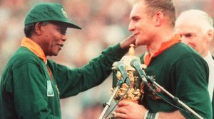 President Nelson Mandela handing over the Webb Ellis trophy when South Africa won the Rugby World Cup in 1995