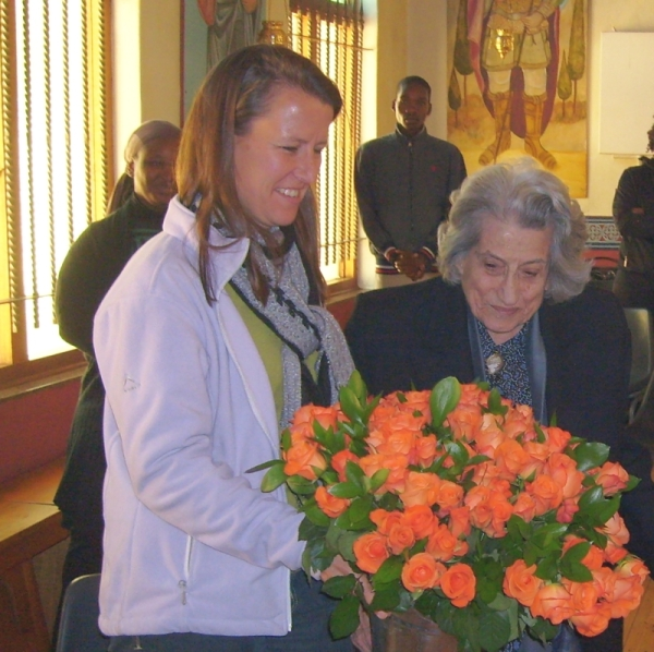 LynnKatsoules presented Elly Mullinos with 100 roses on behalf of the parish