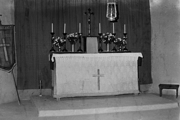 The altar of Holy Cross Anglican Church, Onamunama. Note the sanctuary lamp