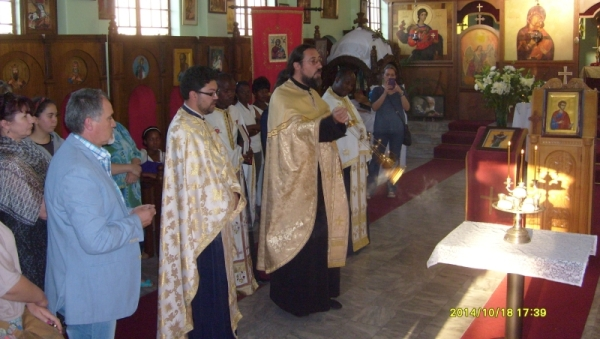 Vespers and Litiya at the Patronal Feast of St Thomas's, Sunninghill. The parish priest, Fr Isailo, censing the five loaves