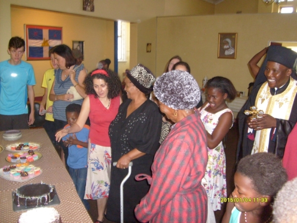 After the service there was a borthday cake in the hall