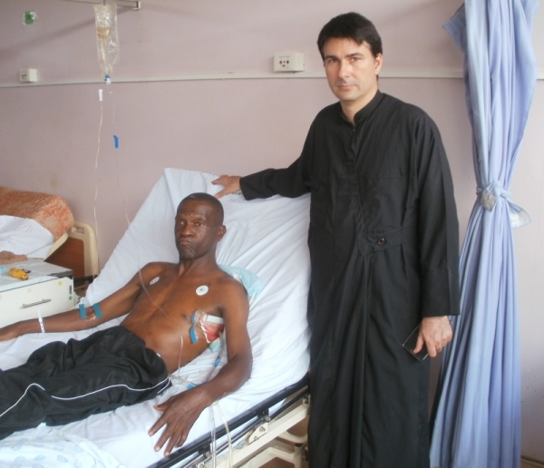 Fr Elias visiting Artmius Mangena in hospital after he was shot by robbers