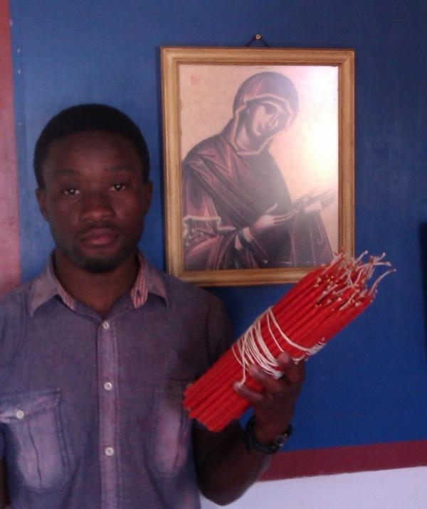 Victor Rhema with some of the candles he makes at the monastery