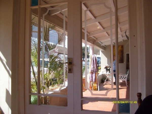 We had coffee in the Old Harbour Cafe, and beyond it was an art gallery, glimpsed here through the door at the end of the veranda