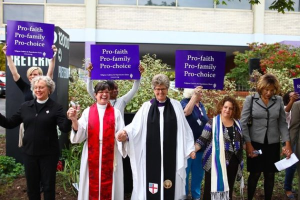 Methodist, Episcopalian and other clergy blessing an abortion clinic. From left to right: Rev. Dr. Shawnthea Monroe, Rev. Laura Young, Rev. Tracey Lind, Rabbi Allison Vann, Rev. Dr. Susan K. Smith