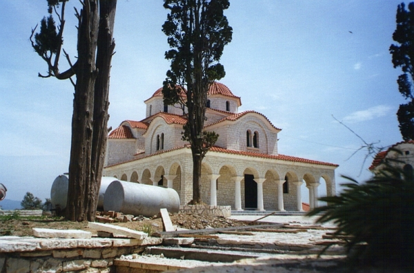 Church at Shen Vlash (St Blaise), Albania, rebuilt after the previous one had been destroyed during the atheist period (1967-1991). To the right is the chapel where people come to light candles and venerate St Blaise.