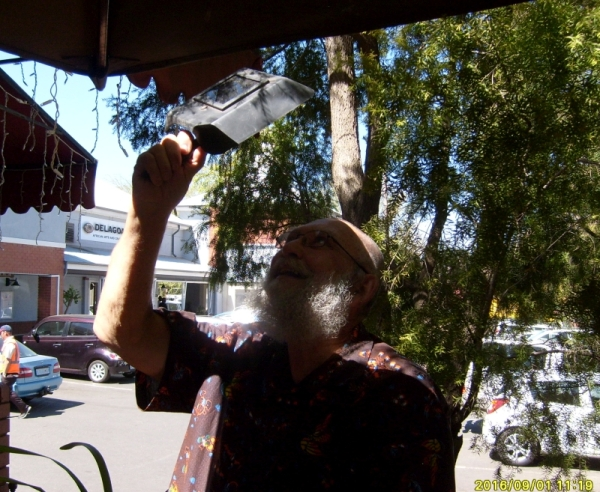 Pete Beukes checking on the solar eclipse