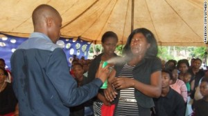 "Orophet Lethebo Rabalago sprays Doom insecicide at people to ""heal"" them."