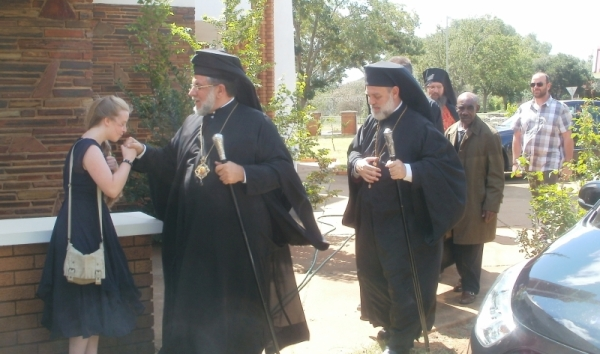 Archbishop Damaskinos being greeted by a member of the congregation, followed by Metropolitan Demetrios of Tanzania, Fr Seraphim,