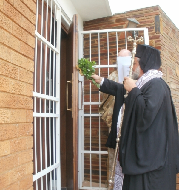 Archbishop Damaskinos blessing the entrance to the temple